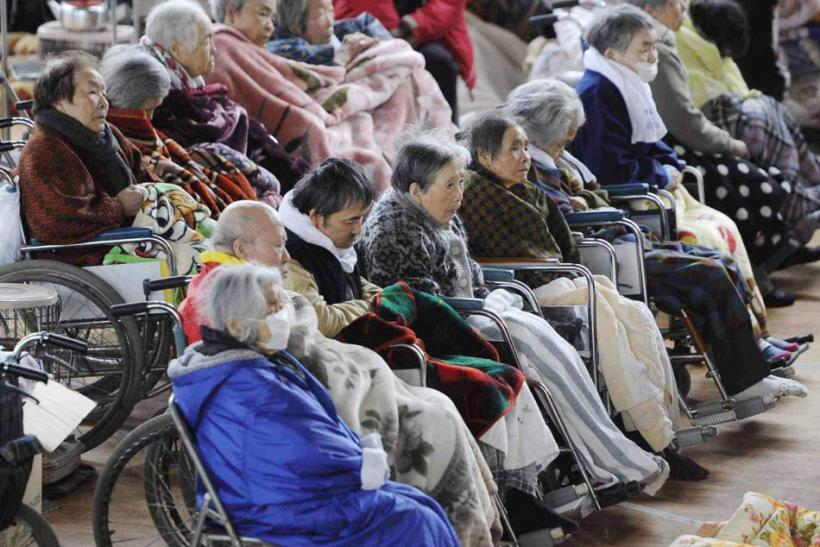 People on their wheelchairs rest at an evacuation centre in Kesennuma