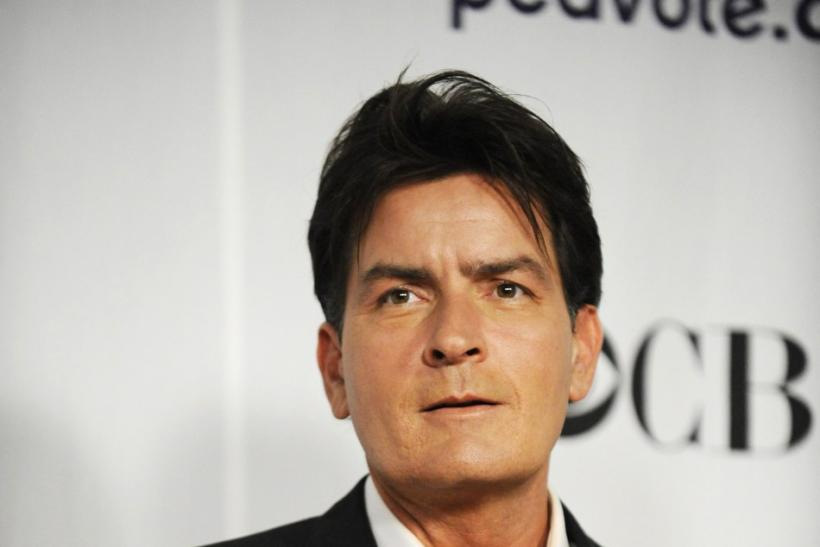 "Actor Charlie Sheen stands backstage after winning the award for Favorite TV Comedy for ""Two and a Half Men"" at the 35th annual People's Choice awards in Los Angeles January 7, 2009."