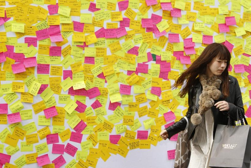 A woman walks away from a message wall after writing a message to the victims of last week's earthquake and tsunami in Japan in central Seoul March 16, 2011.