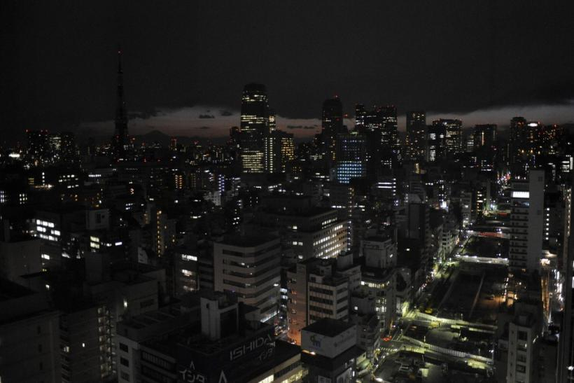 Lights are turned off to save energy before rolling blackouts in Tokyo
