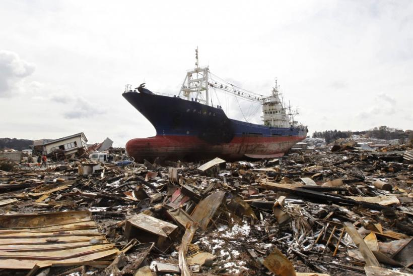 A ship brought in by the tsunami is seen at a devastated area hit by the earthquake and tsunami in Kesennuma