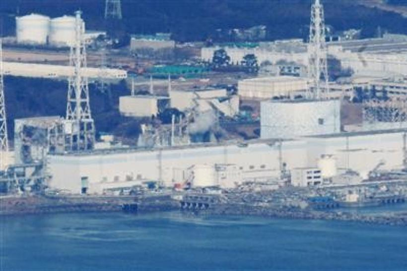 Japan hopes to restore power at two crippled reactors Friday