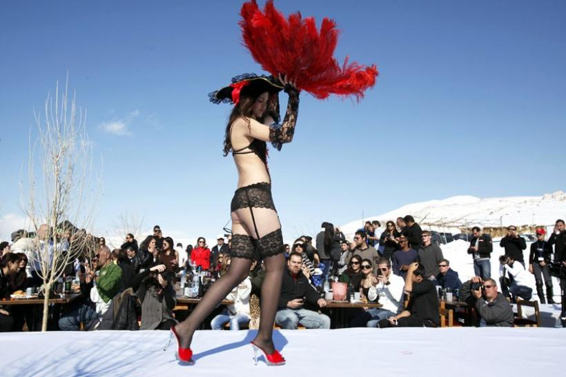 A model presents a creation for K-Lynn lingerie during a snow fashion show in Faqra