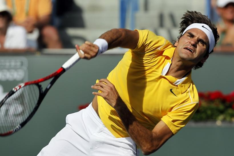 Federer serves to Wawrinka during their quarter-final match at the Indian Wells ATP tennis tournament in Indian Wells.