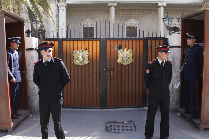 Guards keep watch outside the Interior Ministry at Marjeh square in central Damascus
