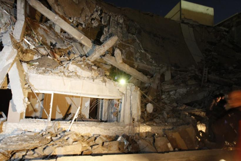 A view of the building, destroyed in what the government said was a western missile attack, inside Bab Al-Aziziyah