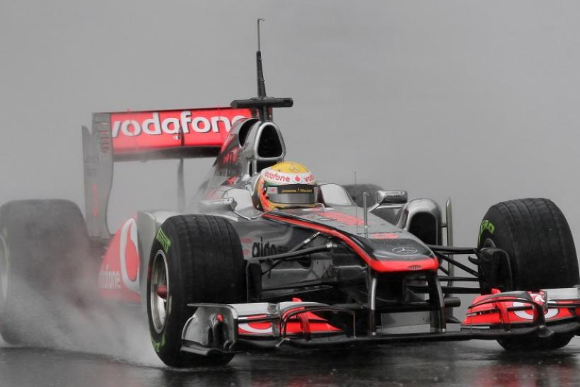 McLaren Formula One driver Hamilton drives in the rain during a training session in Montmelo.