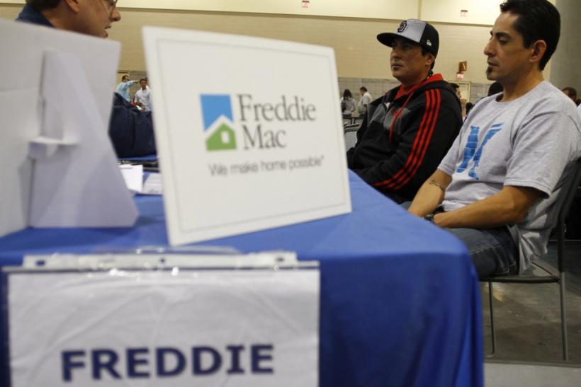 Home owners speak with a Freddie Mac representative in Phoenix