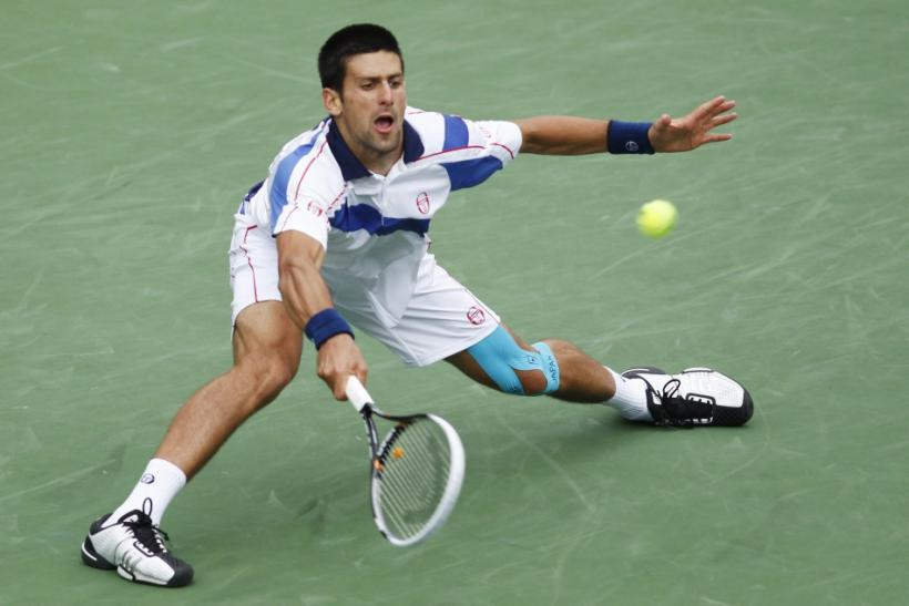 Djokovic of Serbia returns a shot against Nadal of Spain during the men's final of the ATP tennis tournament in Indian Wells.