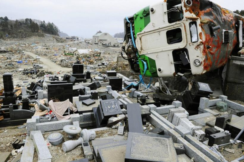 A train car swept by a tsunami lies in a heavily damaged cemetery in Onagawa, Miyagi Prefecture, northeastern Japan