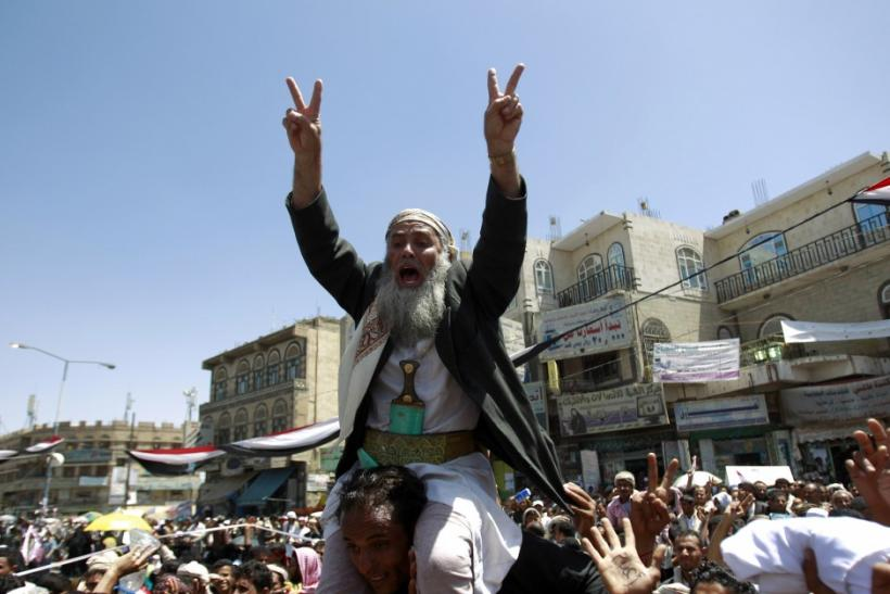 An anti-government protester shouts slogans during a rally demanding the ouster of Yemen's President's Ali Abdullah Saleh in Sanaa March 21, 2011.