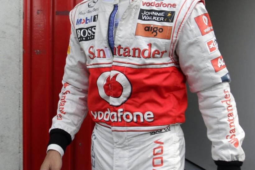 McLaren Formula One driver Lewis Hamilton qualifies pole position in Malaysia Grand Prix