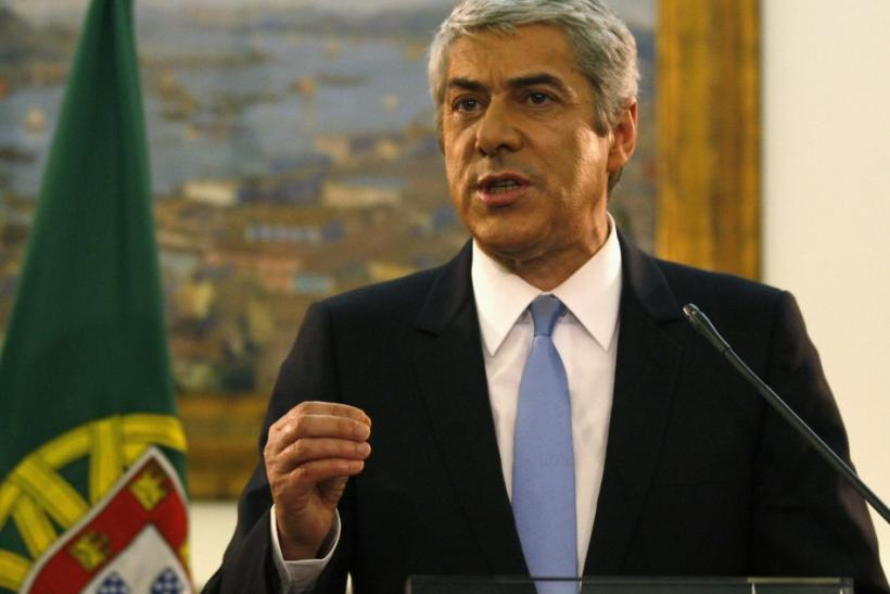 Portuguese Prime Minister Jose Socrates announces his resignation to journalists during a news conference at his official residence in Sao Bento in Lisbon