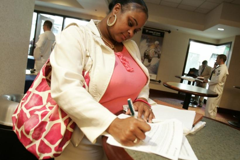 Cherise Campbell fills out an application at a job fair in Pittsburgh
