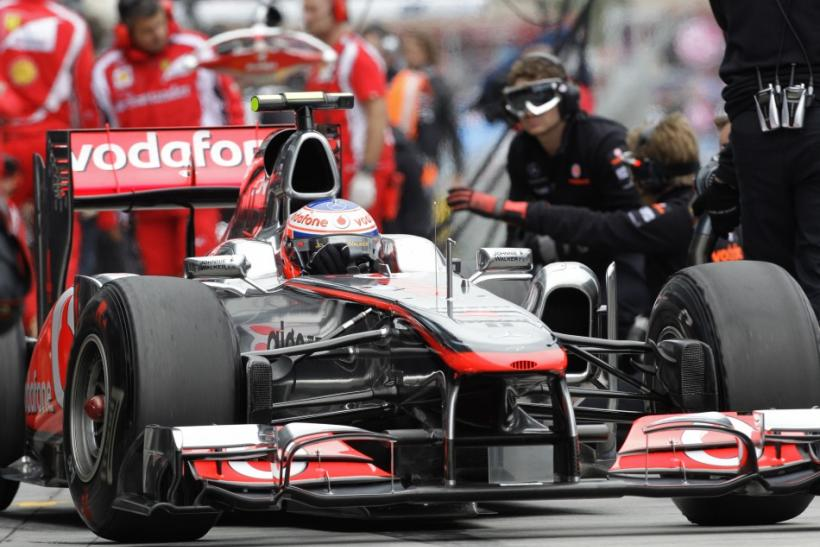 McLaren Formula One driver Button of Britain drives out of the pits during the first practice session of the Australian F1 Grand Prix at the Albert Park circuit in Melbourne.