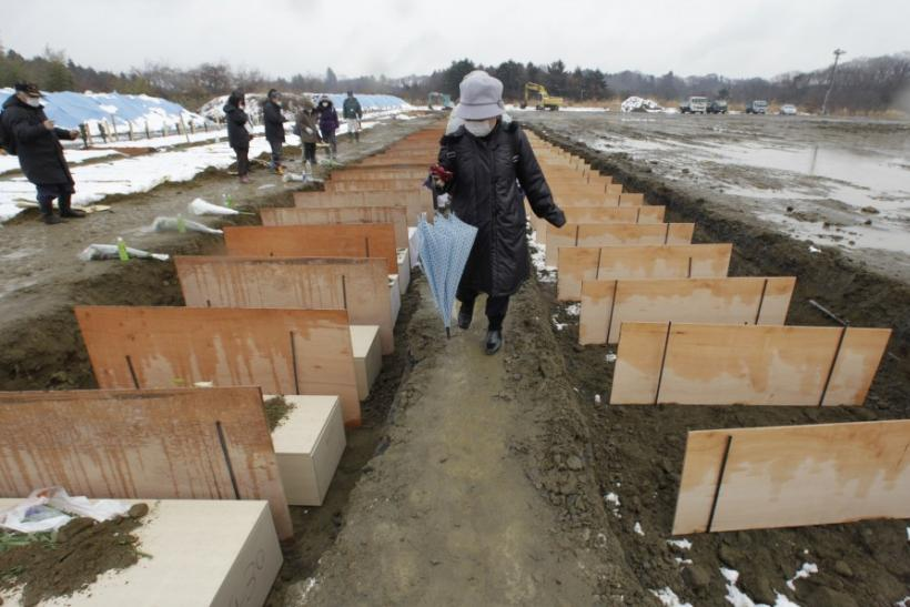 As world watches Fukushima nuclear plant, Japan mourns deaths in silence