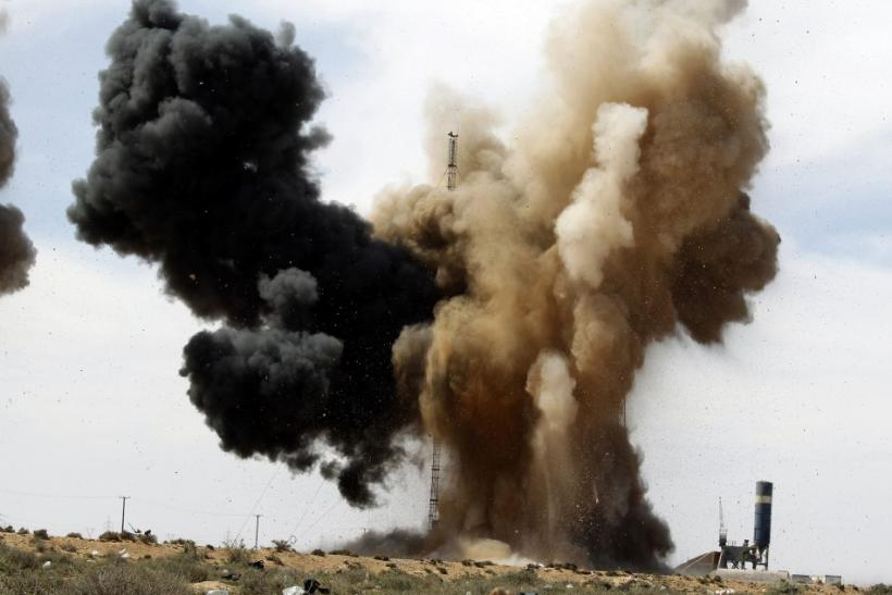 Smoke rises during an air strike at a rebel fighters checkpoint in Al Ugaila.