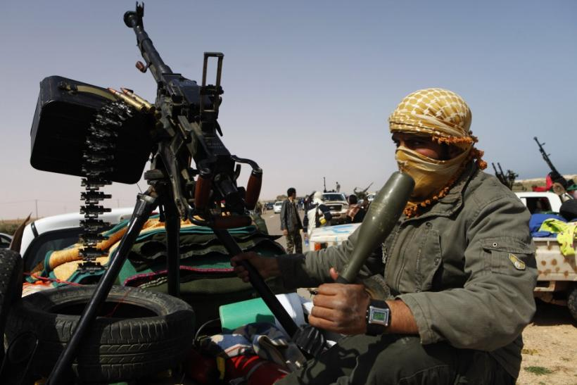 Rebel fighter rides west in pursuit of forces loyal to Muammar Gaddafi some 120 km (75 miles) east of Sirte in eastern Libya, March 28, 2011.