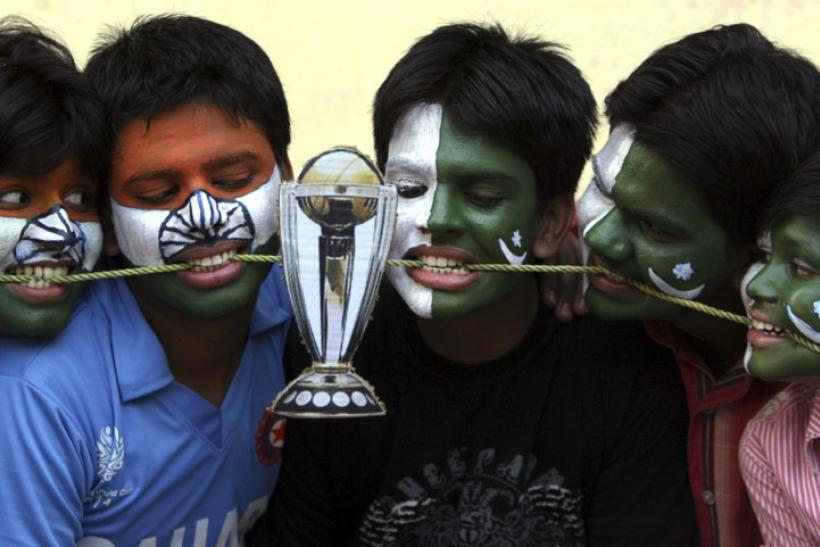 Cricket fans with their faces painted with the Indian and Pakistani national flags
