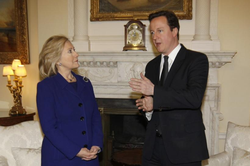 Britain's Prime Minister Cameron speaks to U.S. Secretary of State Clinton inside 10 Downing Street in London