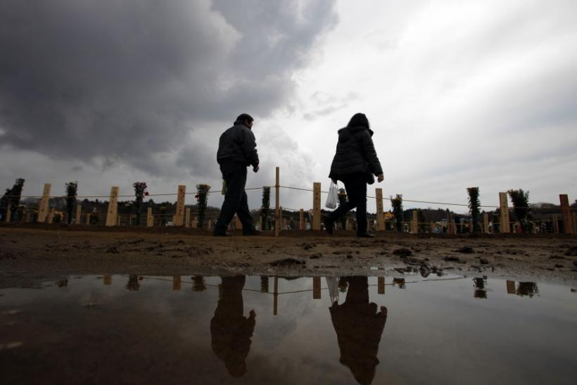 People visit a temporary mass gravesite for victims of the March 11 earthquake and tsunami in Higashi-Matsushima in Miyagi prefecture, northern Japan