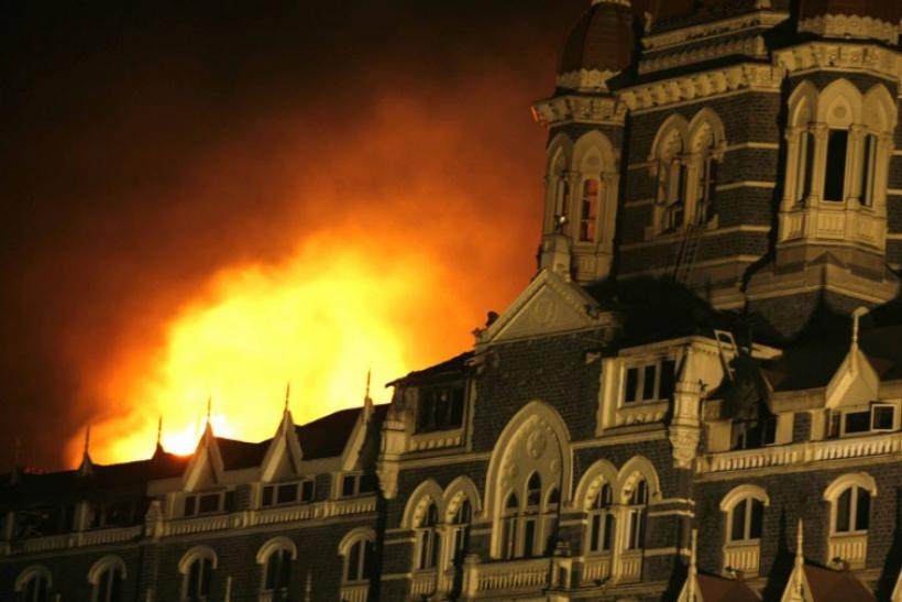Smoke and fire billows out of the Taj Hotel in Mumbai November 27, 2008