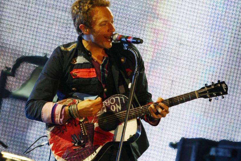 "Rock band Coldplay has topped the album charts with their fifth studio album ""Mylo Xyloto"""