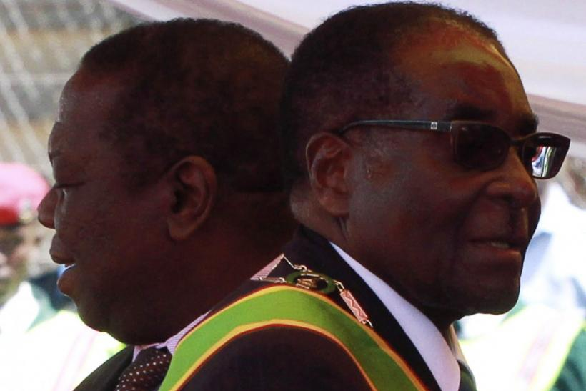 Zimbabwean President Robert Mugabe and Prime Minister Morgan Tsvangirai arrive at a rally marking Zimbabwe's 31st independence anniversary celebrations in Harare