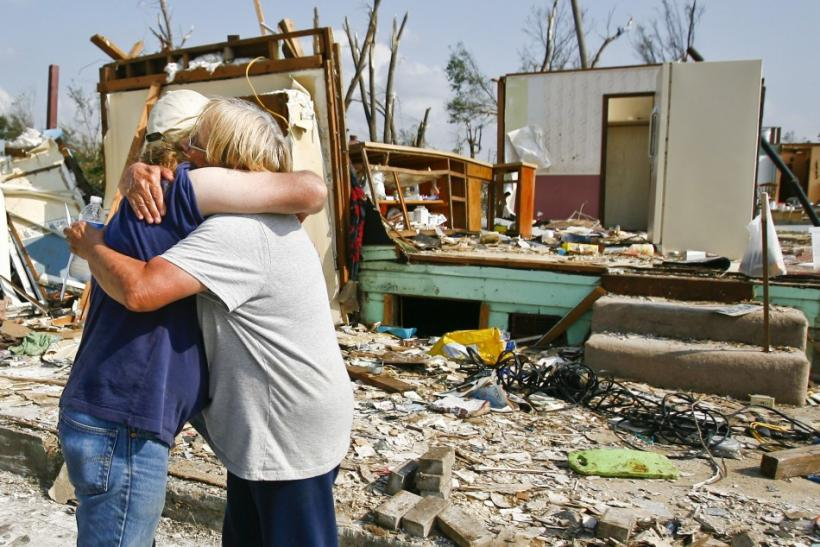 Michael Phillips and Kathi Gale embrace outside their home which was destroyed by the May 22 tornado in Joplin