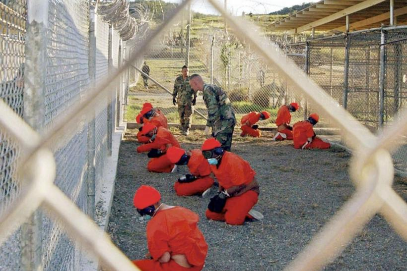 File photo of detainees sitting at Naval Base Guantanamo Bay