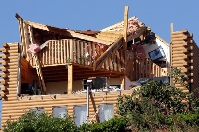 A house is seen damaged after a tornado ripped through on Wednesday in Brimfield