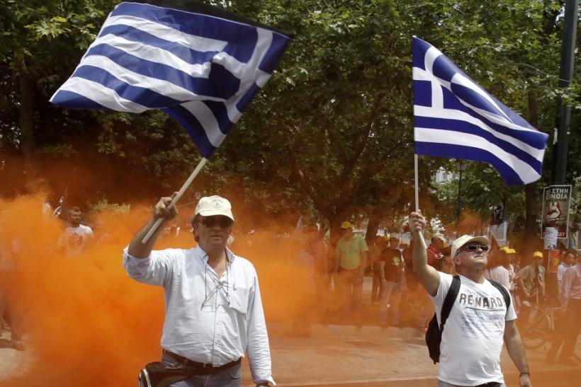 Employees of OTE Telecom wave Greek national flags during a rally against the government's privatisation plans in Athens