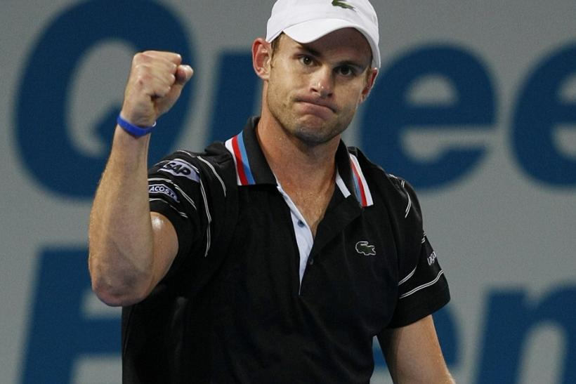 Andy Roddick of the U.S. celebrates beating France's Richard Gasquet at the Brisbane International tennis tournament January 8, 2010.