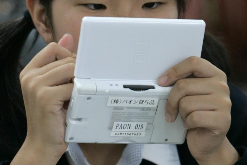 A student uses English-learning software on a Nintendo DS during a media event at Tokyo Girls Junior High School