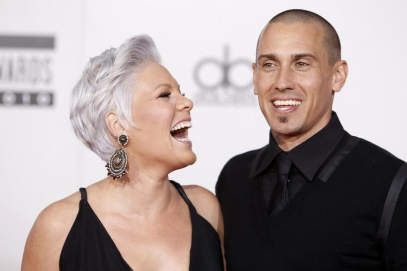 Singer Pink and husband, motocross racer Carey Hart, arrive at the 2010 American Music Awards in Los Angeles November 21, 2010.