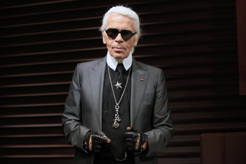 German designer Karl Lagerfeld poses as he unveils his hotel suite creation made of chocolate, part of a campaign by a leading ice cream brand, at a hotel in Paris April 28, 2011.
