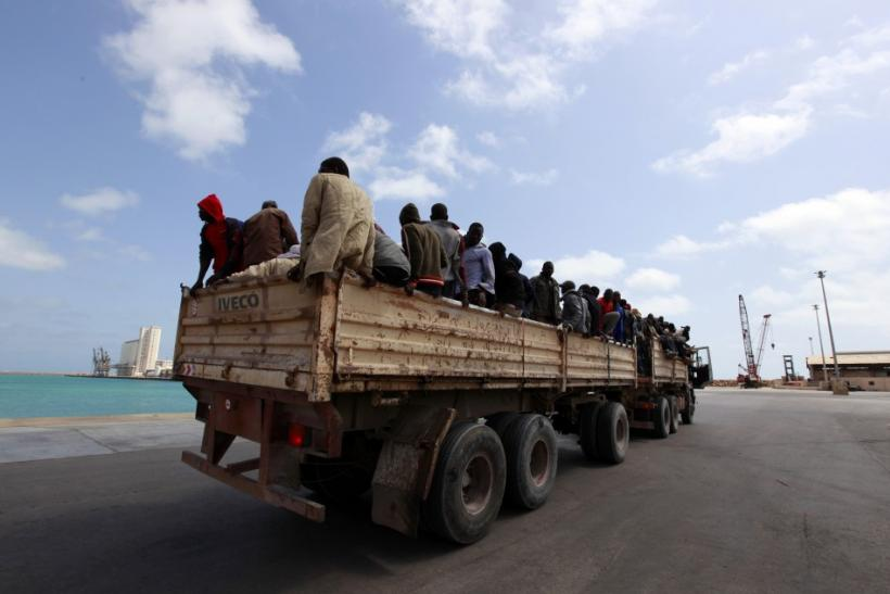 Migrant workers from Niger are transported into Misrata port to be evacuated to Benghazi