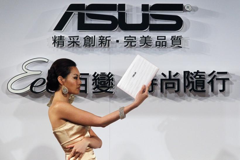 A model displays a ASUS netbook during a media launch in Taipei