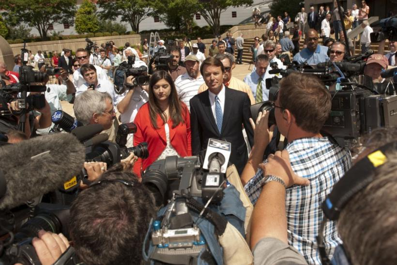 John Edwards and his daughter, Cate Edwards depart from the U.S. District Court in Winston-Salem North Carolina