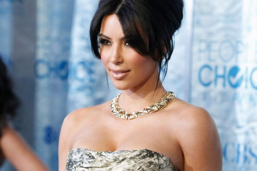 Reality TV star Kim Kardashian arrives at the 2011 People's Choice Awards in Los Angeles