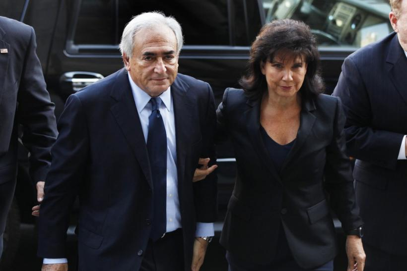 Former IMF chief Strauss-Kahn arrives with his wife Anne Sinclair at Manhattan Criminal Court for his arraignment in New York
