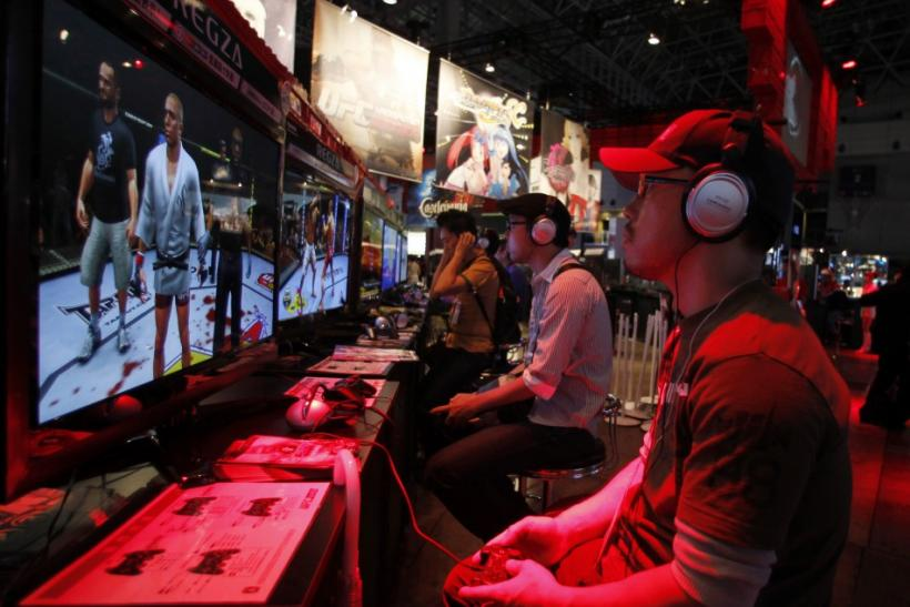 "Visitors try out game software maker Konami Corp's new ""UFC Undisputed 2010"" at Tokyo Game Show in Chiba, east of Tokyo"