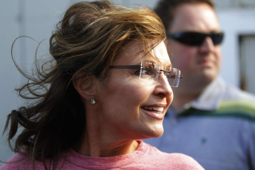 Former Alaska governor Palin looks back at a reporter during her visit to Yankee Seafood Cooperative in Seabrook