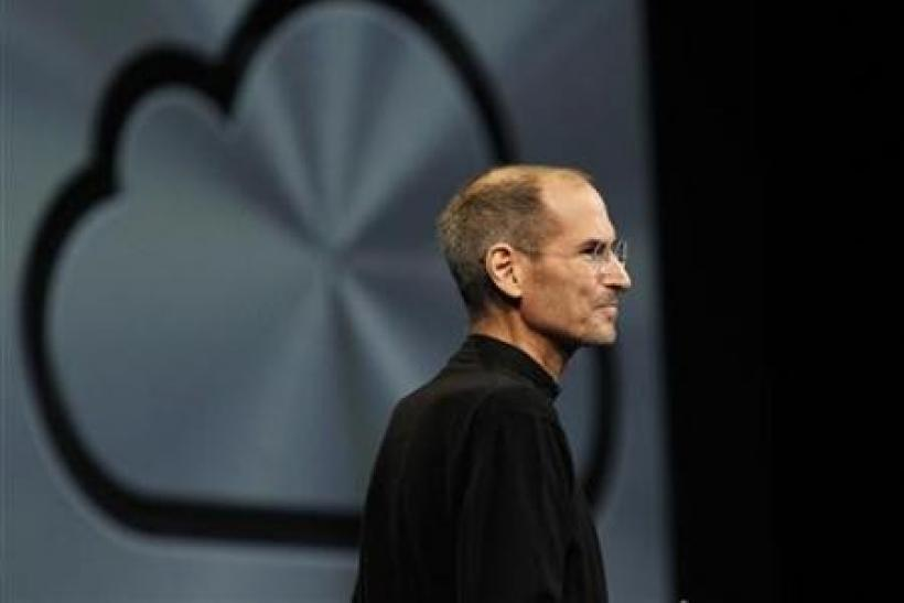 Apple Inc CEO Steve Jobs takes the stage to discuss the iCloud service at the Apple Worldwide Developers Conference in San Francisco June 6, 2011.