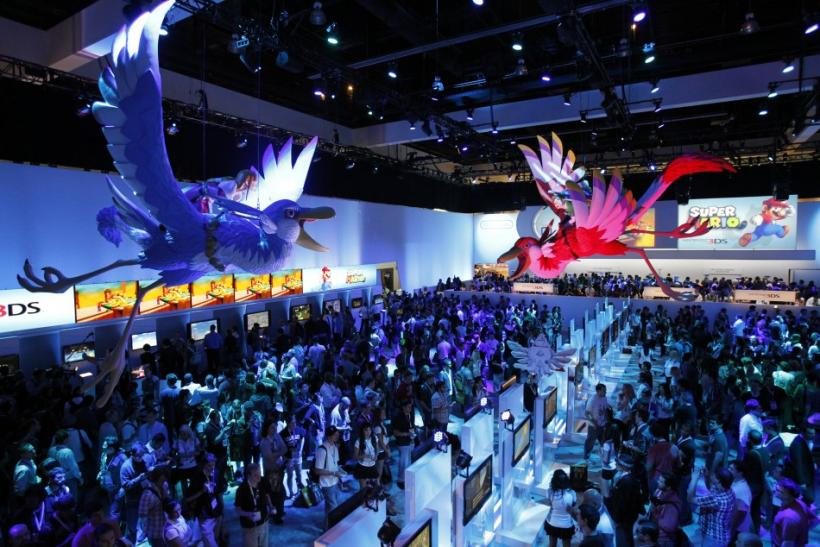 Attendees walk at the Nintendo booth during the Electronic Entertainment Expo, or E3, in Los Angeles June 7, 2011.