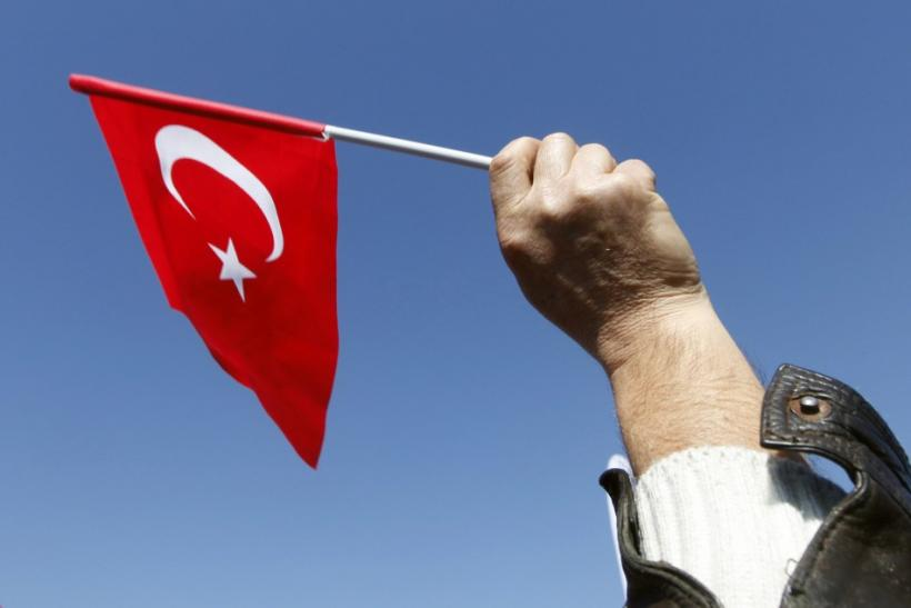 A protester waves the Turkish flag during a demonstration in front of the Silivri prison, near Istanbul