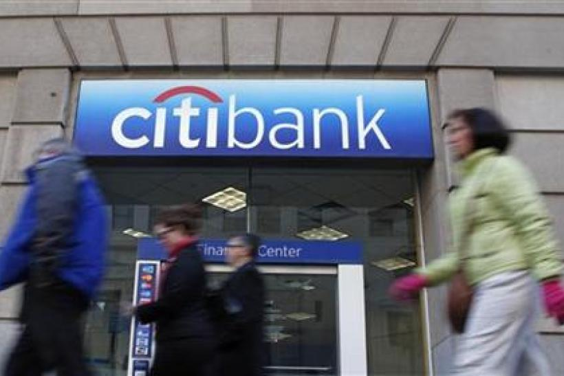 Pedestrians walk past a Citibank branch in Washington