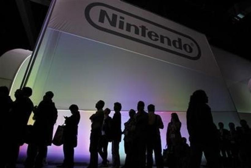 Attendees wait in line to see the new Nintendo Wii U controller during the Electronic Entertainment Expo, or E3, in Los Angeles June 7, 2011.