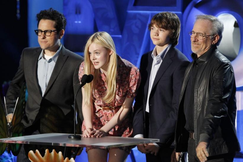 """Super 8"" director JJ Abrams (L), stars Elle Fanning and Joel Courtney, and producer Steven Spielberg"