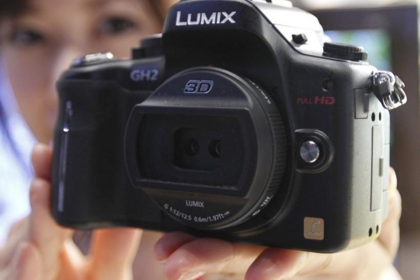 A model shows off a new Panasonic's digital camera